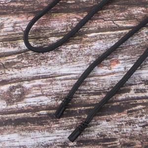 Шнур круглый декор наконечник металл надпись резьба 130см черный уп 2 шт
